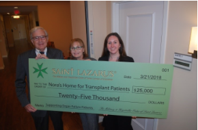 The Military and Hospitaller Order of Saint Lazarus presents $25,000 to Nora's Home.
