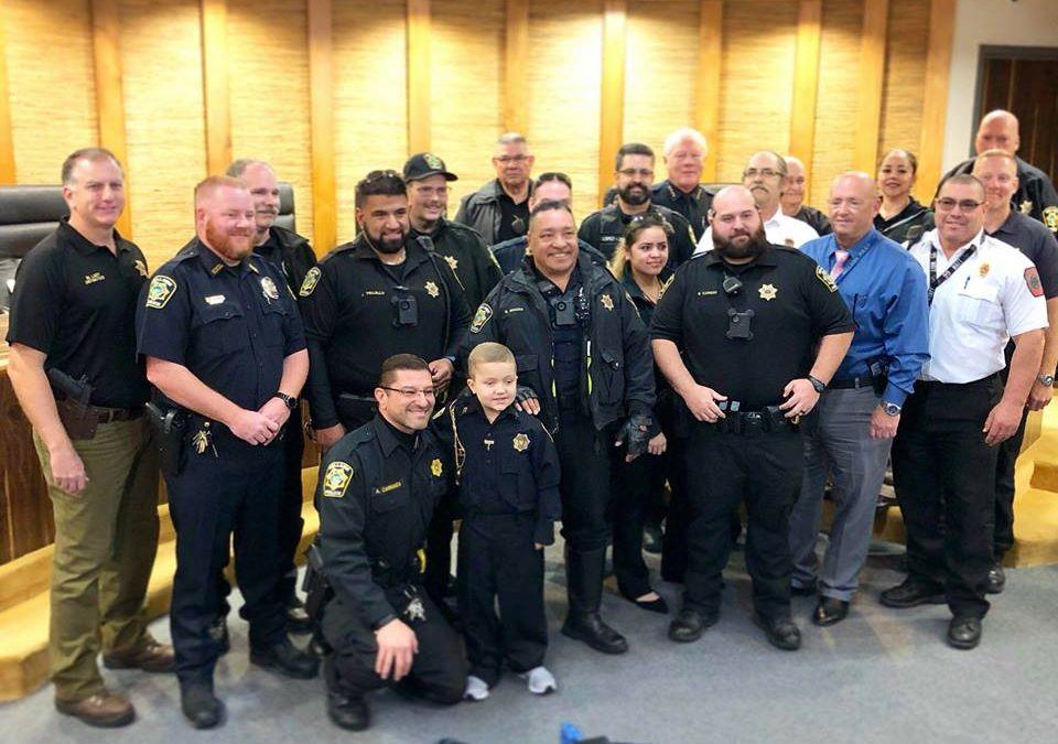 Honorary Officer Max joins BPD for a day ahead of Stuff the Sleigh Toy Drive.